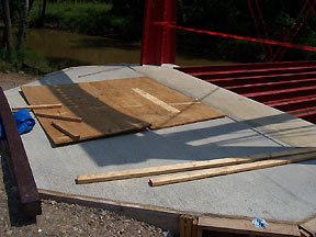 Concrete pad at bridge entrance