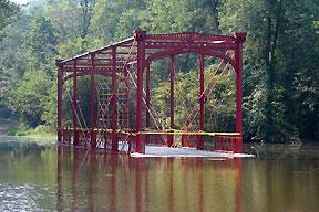 Flood waters surround the bridge