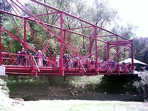 Guests cross the bridge