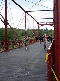 Boy Scout Troop 94 crosses the bridge